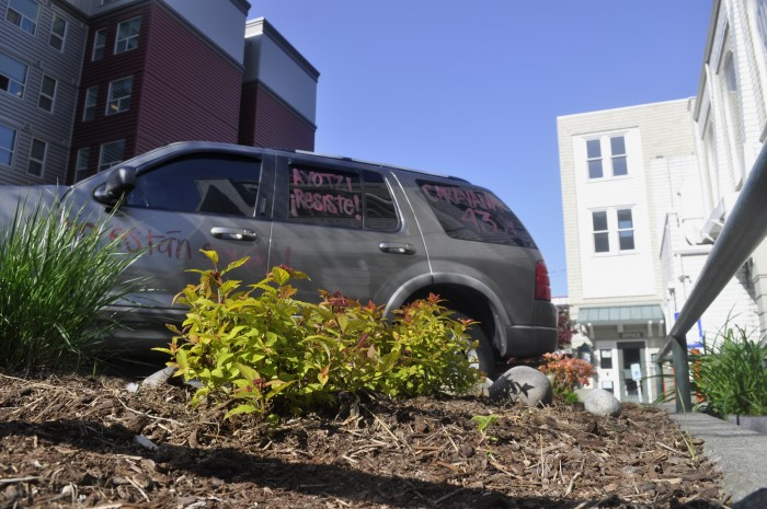 A car outside of Immanuel Lutheran Church, where Caravana43 was hosted in Seattle, decorated with Caravana43 and Ayotzinapa references. (Photo by Janelle Retka)