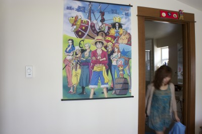 Martina Sun in her room with One Piece poster. (Photo by Tina Lu)