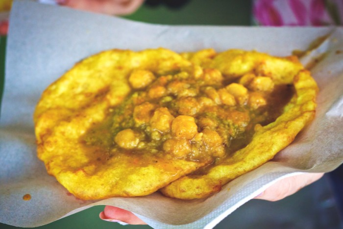 Doubles, a popular street food in Trinidad consisting of chick peas on fried bread, has roots in South Asia but is unique to the Caribbean. (Photo from Flickr by Edmund Gall)