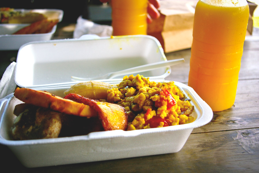 Delicious Jamaican breakfast including ackee, plantain, breadfruit, and mango-pineapple juice. (Photo from Flickr by Christina Xu)