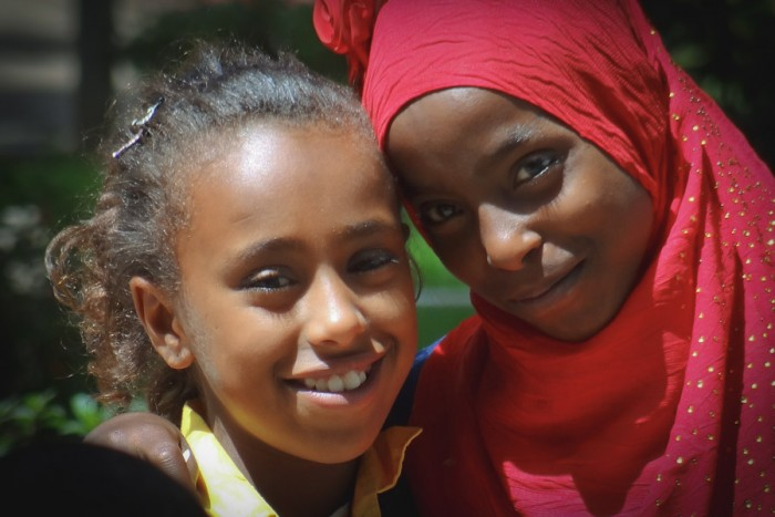 Young Muslim and Christian friends outside the National Museum in Ethiopia, where roughly a third of the population is Muslim and two thirds Christian. (Photo by Adam Jones)