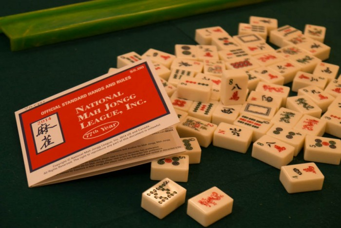 The 2014 version Mah Jongg rule card & the Mah Jongg tiles. (Photo from the Seattle Globalist by Yiqin Weng)
