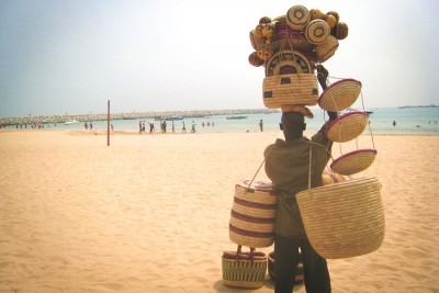 Selling baskets at Tarqa Bay Beach in Lagos. (Photo by Nick M via Flickr)