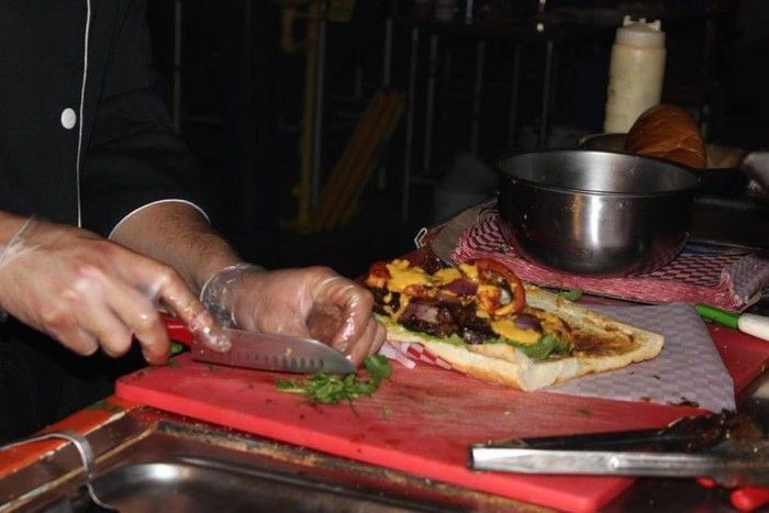 Carlo Antonio Chalisea prepares a Lomo Saltado Sandwich. (Photo by Cristy Acuña)