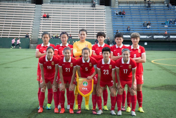 China's Women's National Soccer Team pose for a team shot right before their game against Seattle Reign FC on Friday night. In the front, from left to right: Ruyin Tan, Lisi Wang, Haiyan Wu, Guixin Ren, Yasha Gu. In the back, from left to right: Shanshan Liu, Rong Zhao, Fei Wang, Dongna Li, Shanshan Wang, Jun Ma. (Photo by Yiqin Weng)