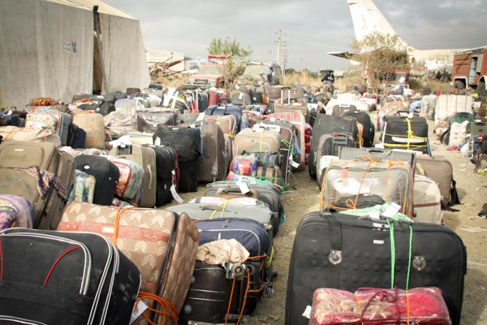 Piles of personal belongings of from among the thousands of Ethiopian migrants repatriated from Saudi Arabia in 2013. (Photo via U.S. Embassy)