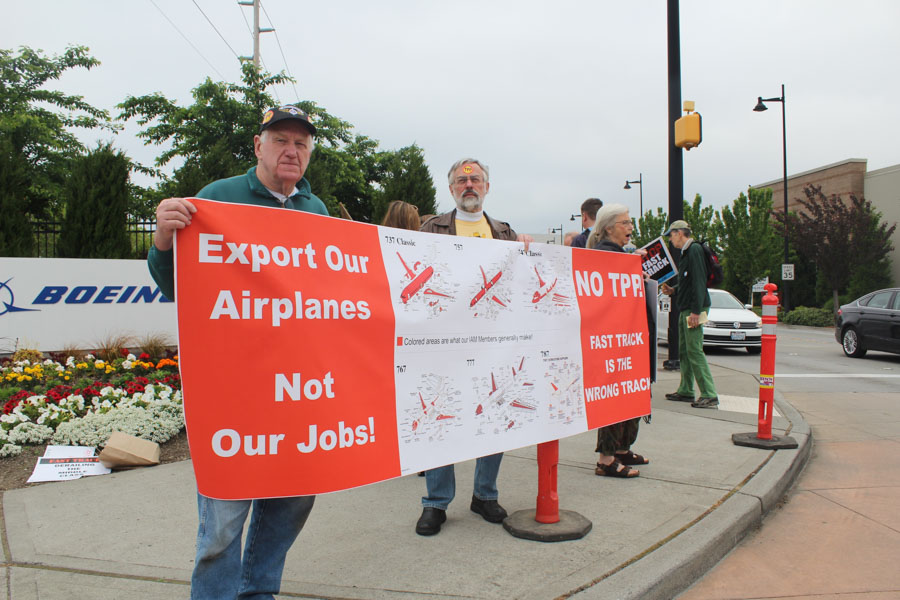 The Washington Fair Trade Coalition and other labor groups demonstrated outside a visit by Secretary of State John Kerry at the Boeing plant in Renton. (Photo by Venice Buhain.)