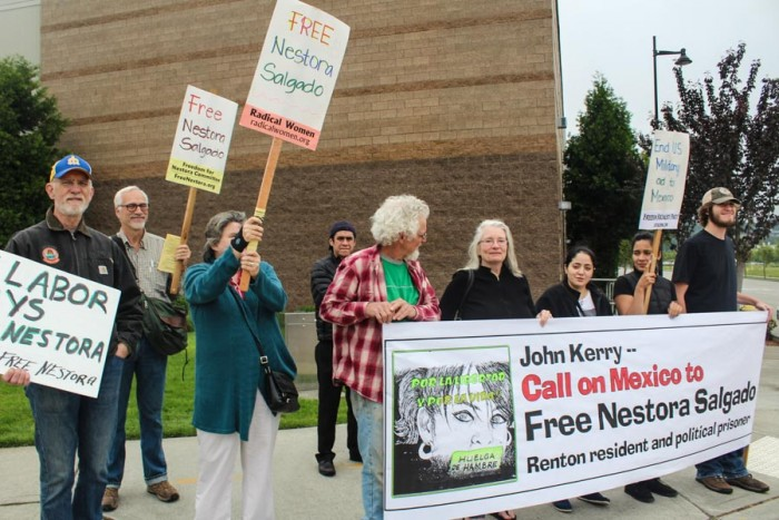Supporters of Nestora Salgado, a Renton woman imprisoned in Mexico, hope to get Secretary of State John Kerry's attention at at appearance at Boeing last May. (Photo by Venice Buhain.)