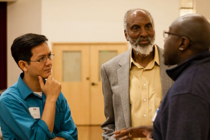 RVC Executive Director Vu Le (far left) at an RVC-sponsored community event in February featuring author john a. powell (middle) discussing how communities of color can work powerfully together. (Photo by Elisabeth Vasquez-Hein)