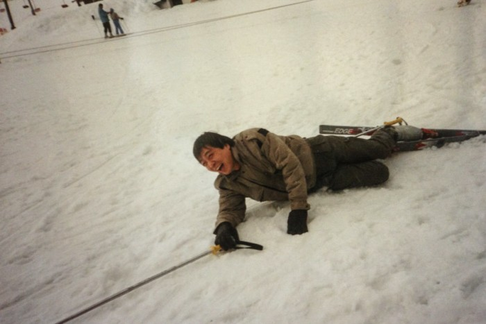 The author's hú lǐ hú tū father falling down after skiing for the first time on Snoqualmie. (Photo courtesy Christina Twu)