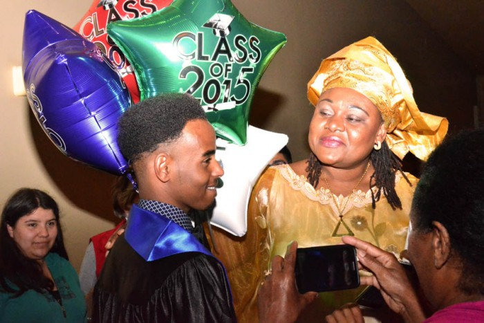 Cynthia Nkeze, ELL teacher at the SWS, looks proudly at her student Abdi Hussein on receiving his high school diploma. (Photo by Valeria Koulikova.)