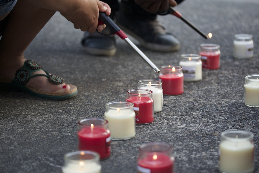 Members of the Nepalese Student Association lit red and white candles on May 29, 2015 for a vigil in remembrance of those struggling and those who have already passed in Nepal. (Photo by Kelsey Hamlin.)