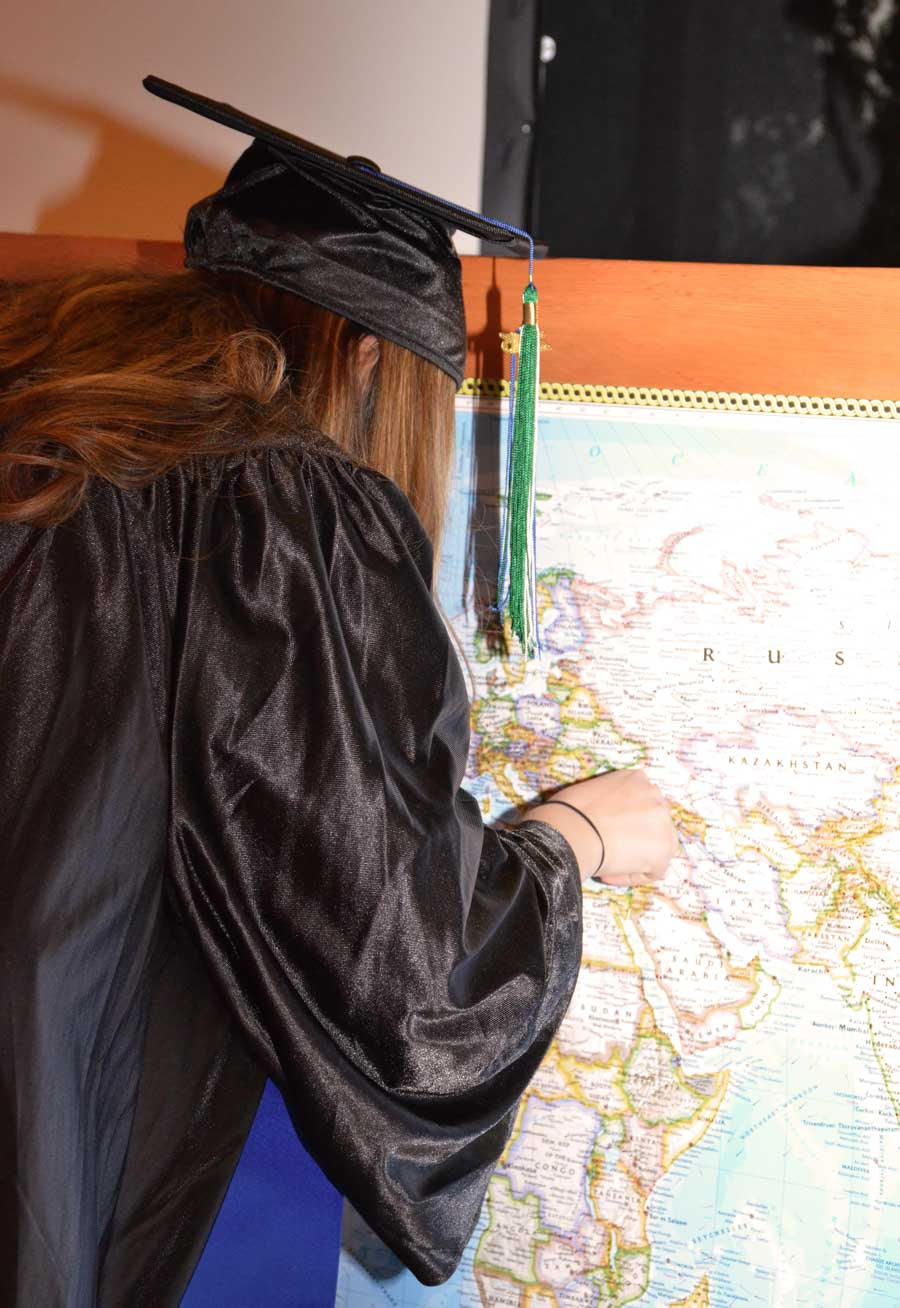 Nino Chaboshvili places her pin on the Senior Gift to the School — a map of the world. (Photo by Valeria Koulikova.)