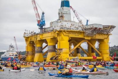 Kayaktivists surround the Polar Pioneer.