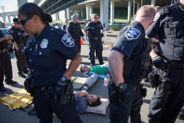 Seattle police arrest protestors blockading access to the Polar Pioneer.