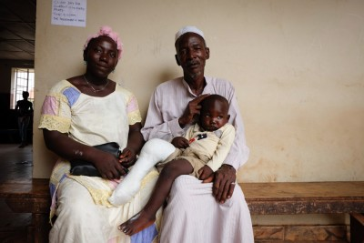 Mohamed rests with his parents after clubfoot treatment. (Photo by Debra Bell)