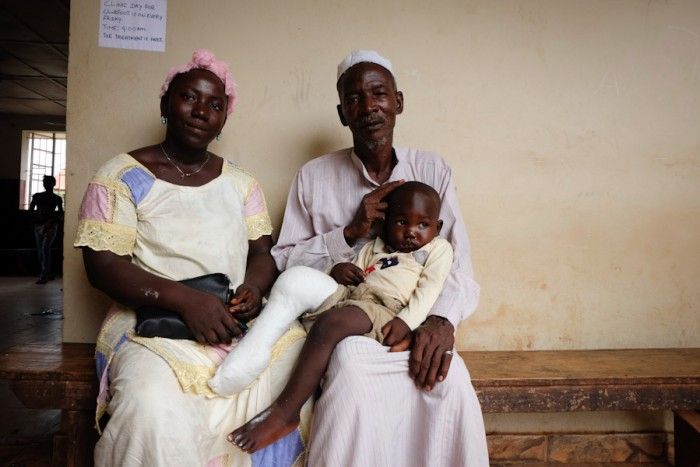 Mohamed Bangura rests with his parents after clubfoot treatment. (Photo by Debra Bell)