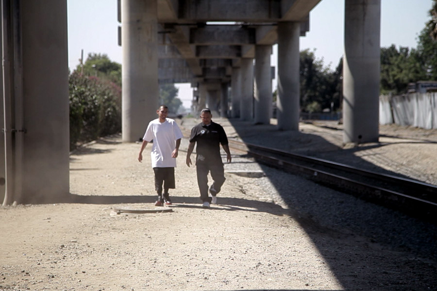 Former gang members work with A Better LA to foster peace being a bridge between the community and the police. (Photo by LTO, LLC.)