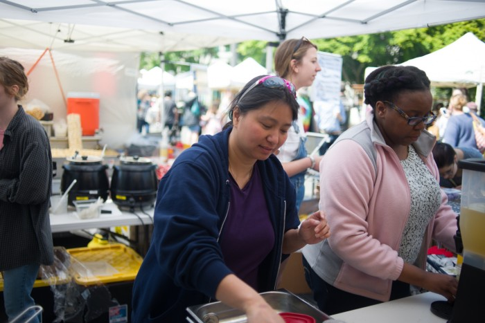 Rosario Carver (left) and Jackie Nikirote (right) are the first small business owners helped by MarketShare, a nonprofit that aims to empower immigrants and refugees by supporting their food business ventures. (Photo by Nick Wong.)