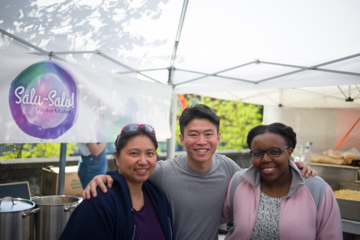 MarketShare founder Philip Deng (center) stands between the nonprofit's first fellows, Rosario Carver (left) and Jackie Nikirote (right). (Photo by Nick Wong.)