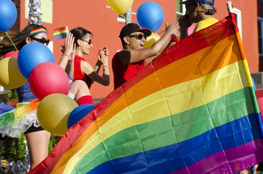 Colors fly at a gay pride parade. (Photo by Tim Brown for the U.S. Department of State via Flickr.)