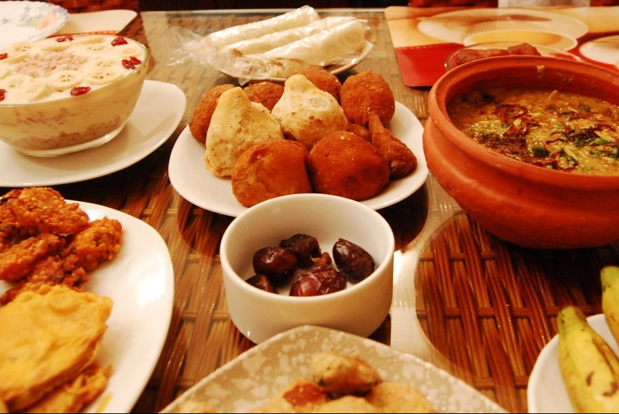 Muslims end their daily fasts during Ramadan with an iftar, an evening meal often eaten with others. (Photo by raasiel via Flickr.)