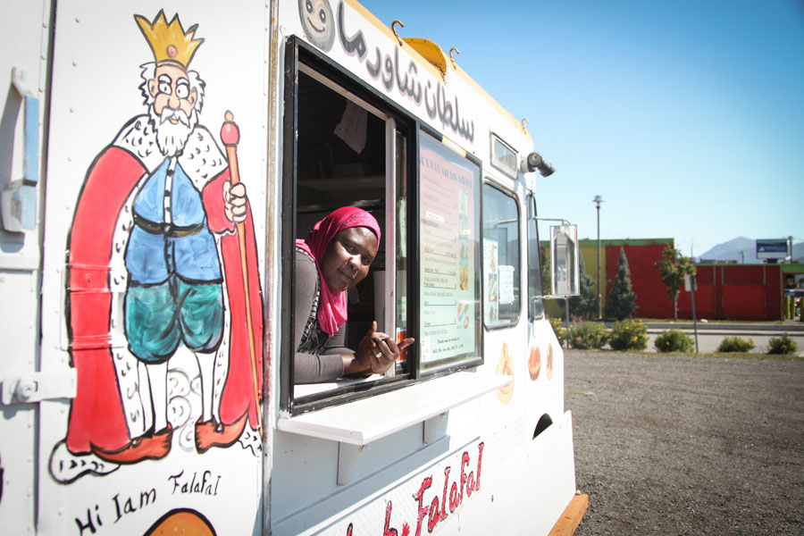 """Omima Adam, 38, who came to Anchorage as a refugee from Sudan 5 years ago and now runs a food truck called """"Sultan Shawarma"""" in Mountain View, hailed as the most diverse neighbhorhood in the U.S. according to data from the 2010 Census. (Photo by Alex Stonehill.)"""