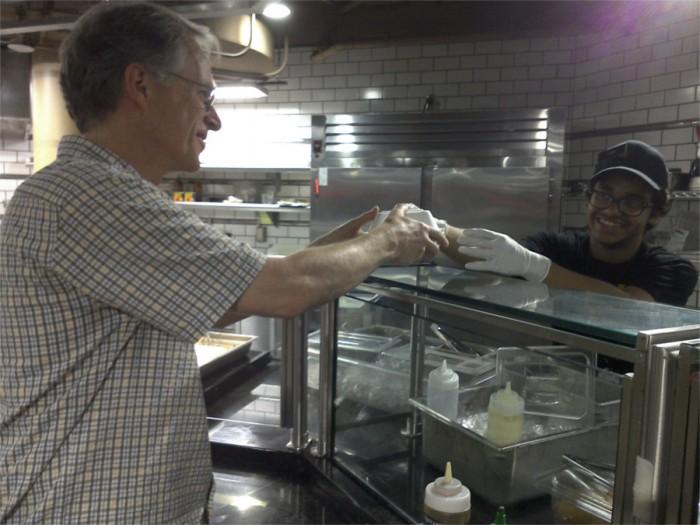 Yashwant Meghare serves a customer at the food court in UW Hub. Photo by Akhila Pingali.