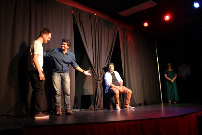 Avinash Verma (center) and Ankit Challa (right) of Improv Comedy Mumbai play an Indian restaurant owner and his inebriated son during an the International Festival of Improvisation at the Market Theatre last weekend. The group is debuting a show called Red, White and Bollywood at the same theatre this weekend. (Photo by Alex Stonehill)
