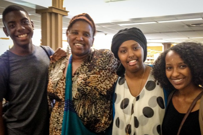 Reagan Jackson (second from left) surrounded by travelers (left to right) Zion Thomas, Azeb Tuji and Eyerusalem Mesele at the Rainier Beach Library researching Mexico before the first Many Voices One Tribe trip abroad. (Photo courtesy Reagan Jackson)