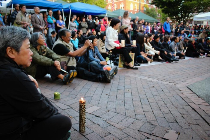 Mourners gathered for a vigil at Hing Hay park in Seattle's International District to honor slain community leader Donnie Chin. (Photo by Venice Buhain.)