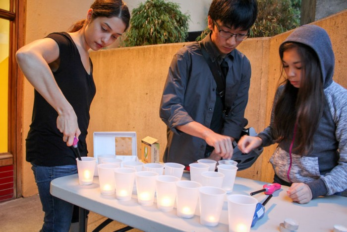 Candles are prepared for the Sunday evening vigil in honor of International District community leader Donnie Chin. (Photo by Venice Buhain.)