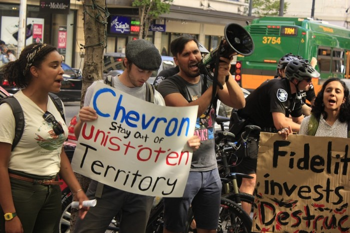Activists protest against Fidelity Investments, Chevron's fourth largest institutional shareholder, outside its office building in downtown Seattle. (Photo by Goorish Wibneh)