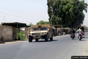 An Afghan National Police armored vehicle patrols on a street in Lashkar Gah capital of Helmand province, Afghanistan Aug. 26, 2015. (Photo by REUTERS.)