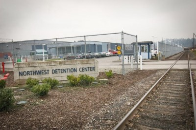 Immigrants and asylum seekers released from the Northwest Detention Center find themselves on the street in industrial Tacoma, thousands of miles from home, with few resources. But now welcome center in a 36 foot RV is their to help. (Photo by Alex Stonehill)