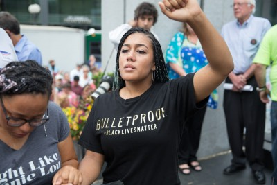 Mara Jacqueline Willaford weeps during a moment of silence for Mike Brown, killed by police last year in Ferguson, Missouri. (Photo by Alex Garland)