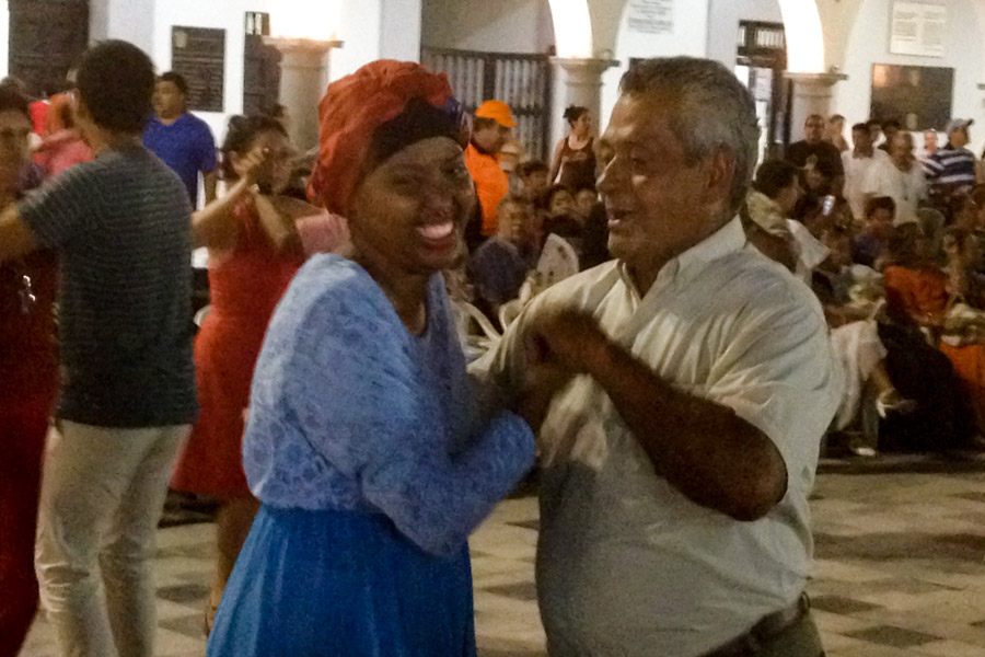 Azeb is coerced onto the dance floor by a man named Victor at the Veracruz Zocalo. (Photo by Reagan Jackson)