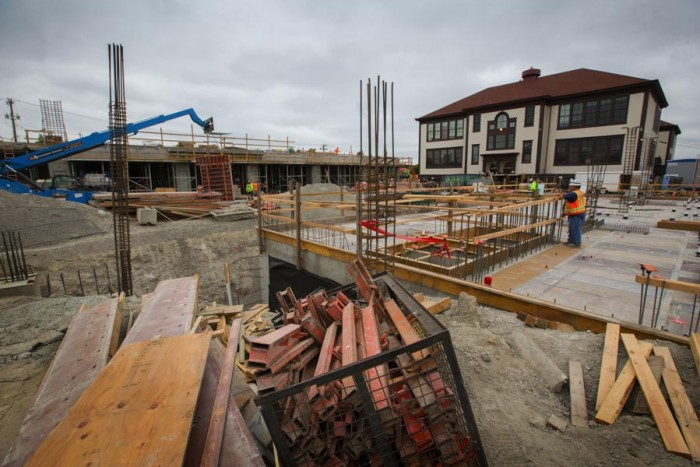 El Centro de la Raza headquarters on Beacon Hill. Construction in the foreground at right is one of the two new buildings. The project will be completed in 2016 and will provide affordable housing for low-income families.  (Photo by Ellen M Banner / The Seattle Times)