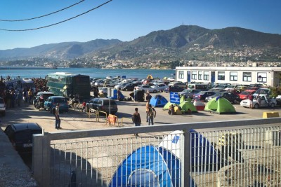 Migrants camped out in the Port of Mytilini, on the Greek island of Lesbos, which is receiving 2,000-3,000 new migrants each day. (Photo by Jennifer Lynne Butte-Dahl)