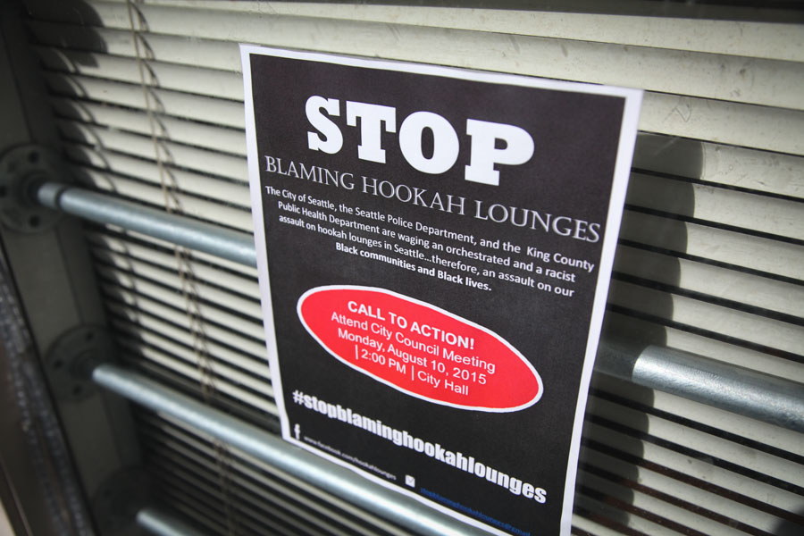 """A sign posted in the window of Cloud 9 hookah lounge in the Central District frames the crackdown as an """"assault on our Black communities."""" (Photo by Alex Stonehill)"""