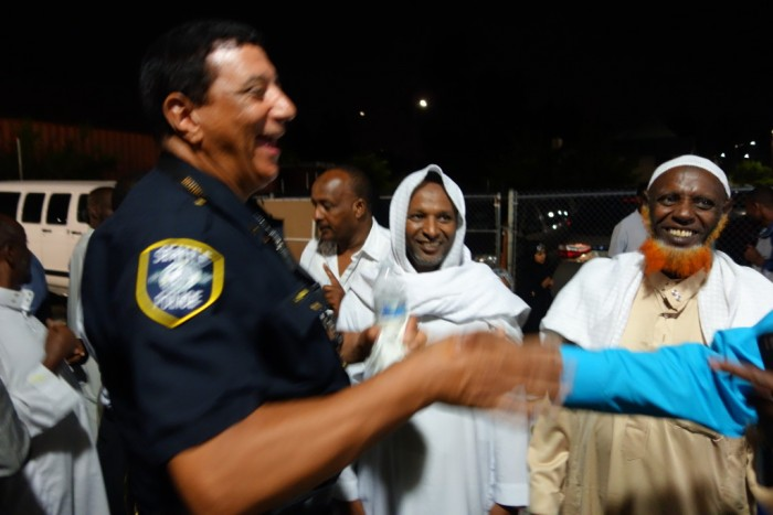Captain John Hayes and his hosts at the Oromo Community Center during a recent iftar. (Photo by Eric Scigliano for Crosscut.)