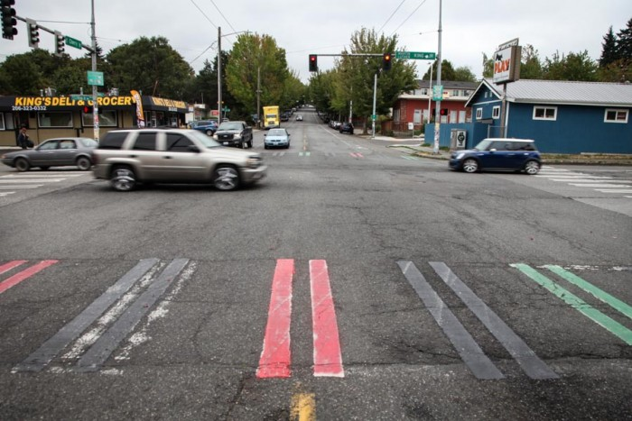 United Hood Movement — an organization of former and current gang members — says they're among those who painted Crosswalks in the Central District red, black and green this weekend. (Photo by Alex Stonehill)
