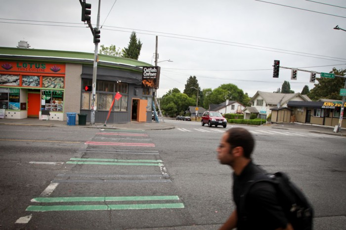 The crosswalk stripes that were colored in by members of United Hood Movement in homage of the neighborhood's African American history will spark a redesign of the crosswalks with input from the community, says the city. (Photo by Alex Stonehill)