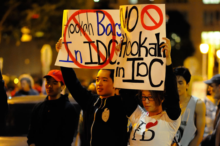After the shooting death of International District leader Donnie Chin, supporters have rallied against hookah lounges, which have caused concern in the neighborhood. (Photo by Isaac Liu for the International Examiner.)