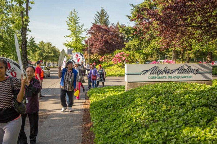 Alaska Airlines food workers demonstrate in May at the airline's corporate headquarters after the company fought the city of SeaTac's voter-approved $15 an hour minimum wage. (Photo by Alex Garland.)