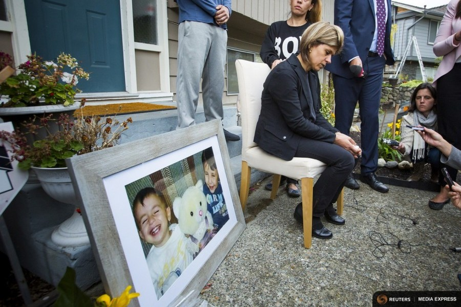 Tima Kurdi, sister of Syrian refugee Abdullah Kurdi whose sons Aylan and Galip and wife Rehan were among 12 people who drowned in Turkey trying to reach Greece, cries while speaking to the media outside her home in Coquitlam, British Columbia (Photo by Ben Nelms for Reuters.)