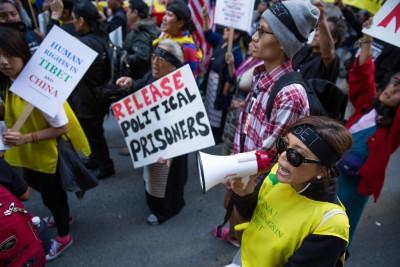 Tibet protestors march (Photo by Alex Garland)