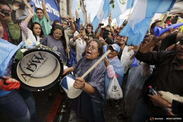 People react outside of the Guatemalan Congress building after a vote to strip President Otto Perez Molina of immunity earlier this month. (Photo from REUTERS/Jorge Dan Lopez)