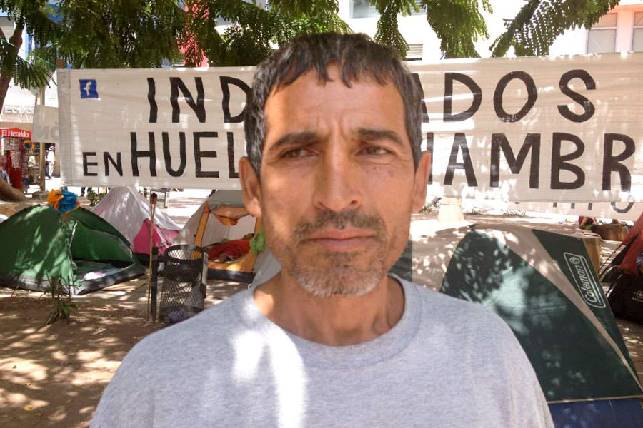 Oscar Maldonado, one of three men on the 14th day of a hunger strike, protesting corruption in Honduras' government. (Photo by Reagan Jackson)
