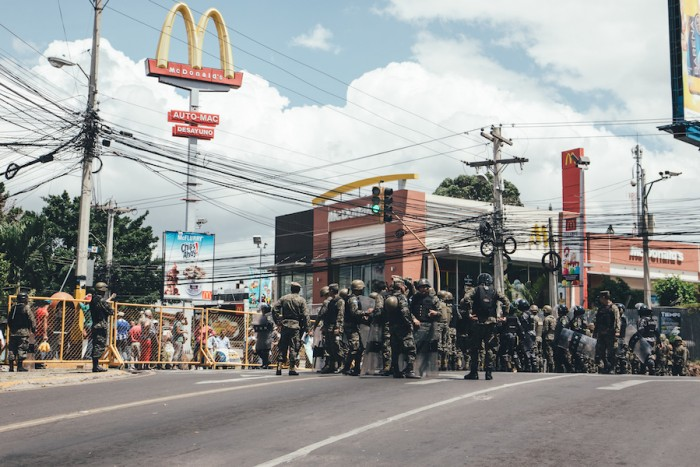 Local police respond to a street protest in Tegucigalpa, Honduras. (Photo by Dan Poss.)